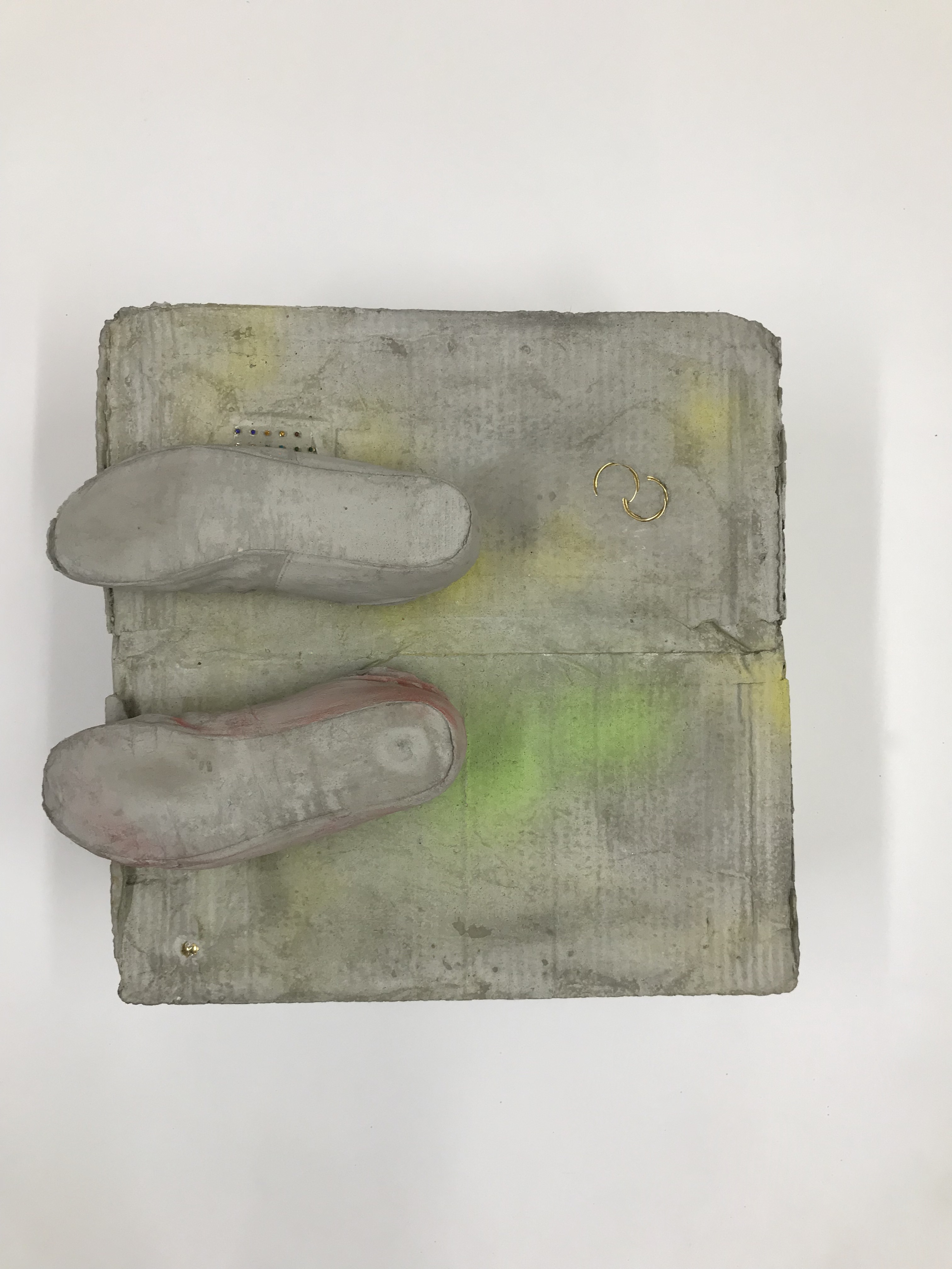 Sculpture by Rachel Walters in cast concrete with jewellery and pigment titled Something about your face, the sun and the shadows